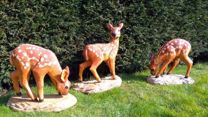 Chainsaw Sculpture Galleries | Three chainsaw carved and painted fawns